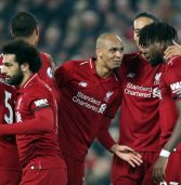Liverpool hits five to stay on top